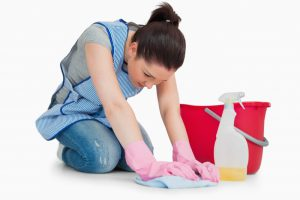 3936283-serious-cleaning-woman-wiping-up-the-floor